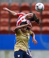 Cris Mabel Flores (PAR) gets to the ball ahead of Sam Johnson (USA)..FIFA U17 Women's World Cup, Paraguay v USA, Waikato Stadium, Hamilton, New Zealand, Sunday 2 November 2008. Photo: Renee McKay/PHOTOSPORT