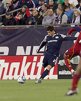 New England Revolution defender Franco Coria (2) passes the ball. In a Major League Soccer (MLS) match, Real Salt Lake defeated the New England Revolution, 2-0, at Gillette Stadium on April 9, 2011.