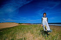 Girl portraying &quot;Anne of Green Gables&quot; on dunes near Park Corner, Prince Edward Island, Canada