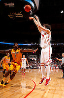 Ohio State Buckeyes guard Amedeo Della Valle (33) takes a three-pointer over Wyoming Cowboys guard Charles Hankerson Jr. (1) during the first half of the NCAA basketball game at Value City Arena in Columbus on Nov. 25, 2013. (Adam Cairns / The Columbus Dispatch)