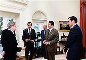 United States President Ronald Reagan meets with foreign policy advisors in the Oval Office of the White House in Washington, D.C. on.Friday, October 14, 1983.  Standing from left are: Robert McFarlane, special U.S. envoy to the Middle East; Vice President George H.W. Bush; U.S. Secretary of State George Shultz; President Reagan; and William Clark, Assistant to the President for National Security Affairs..Mandatory Credit: Jack Kightlinger - White House via CNP
