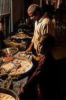 A chef hard at work in the backstreets of Varanasi. (Photo by Matt Considine - Images of Asia Collection)