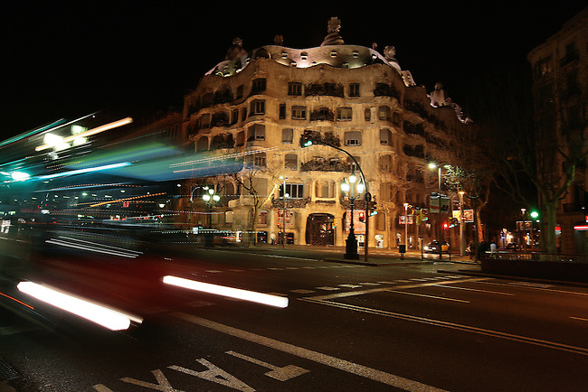 A bus passes at night in front of Gaudi's La Casa Mila in Barcelona, Spain. Feb. 19, 2009.