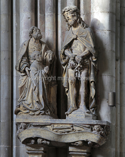 Sculpture from the tomb of Pierre Burry, died 1504, with Pierre Burry kneeling, presented by his patron saint St Peter to Christ as Ecce Homo, early 16th century, in the nave of the Basilique Cathedrale Notre-Dame d'Amiens or Cathedral Basilica of Our Lady of Amiens, built 1220-70 in Gothic style, Amiens, Picardy, France. Amiens Cathedral was listed as a UNESCO World Heritage Site in 1981. Picture by Manuel Cohen