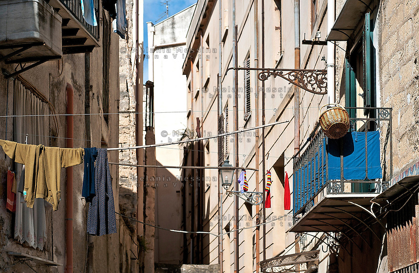 Palermo, hanging clothes in the alley.