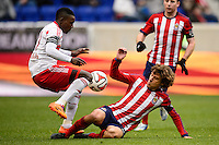 Lloyd Sam (10) of the New York Red Bulls and Agustin Pelletieri (8) of Chivas USA. The New York Red Bulls and Chivas USA played to a 1-1 tie during a Major League Soccer (MLS) match at Red Bull Arena in Harrison, NJ, on March 30, 2014.