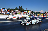 Aug. 4, 2013; Kent, WA, USA: NHRA pro stock driver Vincent Nobile (near) races alongside Greg Anderson during the Northwest Nationals at Pacific Raceways. Mandatory Credit: Mark J. Rebilas-USA TODAY Sports