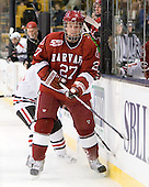 Michael Biega (Harvard - 27) - The Northeastern University Huskies defeated the Harvard University Crimson 4-0 in their Beanpot opener on Monday, February 7, 2011, at TD Garden in Boston, Massachusetts.