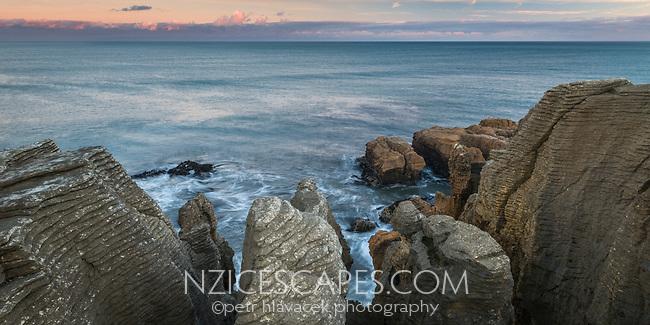 Dawn on coast in Punakaiki with weathered limestone formations, Paparoa National Park, West Coast, New Zealand