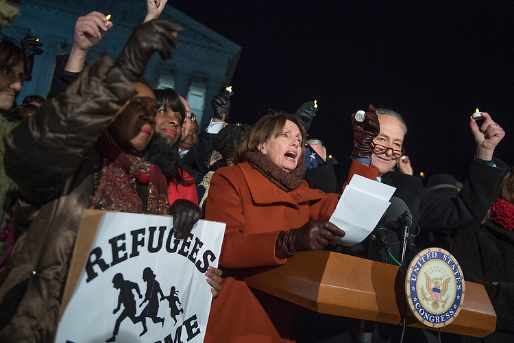 UNITED STATES - JANUARY 30: From left, Reps. Sheila Jackson Lee, D-Texas, Terri Sewell, D-Ala., House Minority Leader Nancy Pelosi, D-Calif., Senate Minority Leader Charles Schumer, D-N.Y., and members of the House and Senate gather in front of the Supreme Court to voice opposition to President Trump's executive order barring immigrants from certain countries entry into the U.S., January 30, 2017. (Photo By Tom Williams/CQ Roll Call)