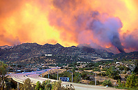 870000035 an uncontrolled raging wildfire burns hillside vegetation in the simi hills above chatsworth along the 118 freeway in los angeles county california