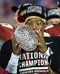 FSU freshman Heisman quarterback Jameis Winston pitches the crystal football in the air after winning the national championship on his birthday and the offensive MVP at the BCS national title game at the Rose Bowl in Pasadena, California on January 6, 2014.  Florida State Seminoles defeated the Auburn Tigers 34-31 for the title.