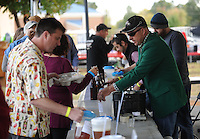 NWA Democrat-Gazette/ANDY SHUPE<br /> Doug Brames of Springdale (right) speaks with visitors Saturday, Oct. 17, 2015, as he serves a sample of one of his home-brewed beers during the second St. Raphael Catholic Church Brewtober Chilifest in Springdale. The event gave attendees the chance to taste home-brewed beers and ciders and sample chili with awards going to the two winners as determined by a popular vote.