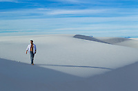 one man walking in the sand dunes of White Sands National Park, New Mexico