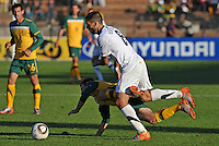 Clint Dempsey of USA fouls Luke Wilkshire of Australia....Football - International Friendly - USA v Australia - Ruimsig Stadium