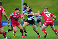 Matt Banahan of Bath Rugby takes on the Scarlets defence. Pre-season friendly match, between the Scarlets and Bath Rugby on August 20, 2016 at Eirias Park in Colwyn Bay, Wales. Photo by: Patrick Khachfe / Onside Images