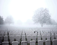 Fog envelopes headstones in the Hooge Crater Commonwealth War Cemetery where almost 6,000 men, killed in the Ypres Salient during World War I, are laid to rest.