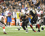 New Orleans Saints Pierre Thomas (23) vs. New York Giants Deon Grant (34) at the Superdome in New Orleans, La. on Monday, November 28, 2011. New Orleans won 49-24.
