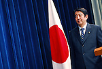 Shinzo Abe, prime minister of Japan, poses for photographers before a news conference at the prime minister's office in Tokyo on 05 July, 2007. During the conference, held following the end of the regular Diet session, Japan's beleagured leader said he bore responsibility for appointing two Cabinet ministers who resigned and a third who committed suicide in late May. He would not be drawn on the subject of whether the Cabinet would face a reshuffle following the July 28 upper house elections, nor would he comment on the number of seats he expects his ruling Liberal Democratic Party to win in the election.Shinzo Abe, prime minister of Japan, poses for photographers before a news conference at the prime minister's office in Tokyo in July, 2007.   .Photographer: Rob Gilhooly