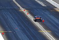 Jun 18, 2016; Bristol, TN, USA; NHRA pro mod driver Dan Stevenson crosses the center line and hits the foam block centerline timing blocks during qualifying for the Thunder Valley Nationals at Bristol Dragway. Mandatory Credit: Mark J. Rebilas-USA TODAY Sports