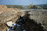 near Port Au Prince, Haiti, Jan 26 2010.More than 75000 bodies have been buried in mass graves by employees of CNE (Centre National d'Equipement), a state run company in Titanyen, about 15 km north of Port au Prince..