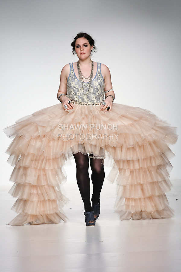 Model walks runway in an outfit from the Metropolis collection by Sarah Lind, during the Pratt 2011 fashion show.