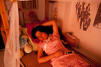 After finishing work Luo Yang sleeps in her dormitory at The West Lake Restaurant. She is still in the uniform of an 'Imperial Waitress', worn by staff serving in the area of the restaurant that emulates an Imperial Palace. Able to seat up to 5,000 people at one sitting, The West Lake Restaurant is the biggest Chinese restaurant in the world. Each week its diners, who staff are taught are 'the bringers of good fortune', devour 700 chickens, 200 snakes, 1,200 kgs of pork and 1,000 kgs of chillis. Its 300 chefs cook in five kitchens and its staff total more than 1,000.It is fully booked most nights.