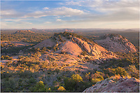 Daybreak arrives at Enchanted Rock State Park. This landscape from the Llano Uplift between Llano and Fredericksburg looks north and was taken from the point of Turkey Rock, just east of of the famous granite mound.