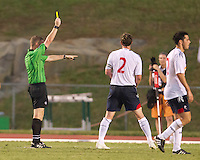 The referee hands out a yellow card in the Charlotte Eagles match against the Bolton Wanderers.  The Charlotte Eagles currently in 3rd place in the USL second division play a friendly against the Bolton Wanderers from the English Premier League.charlotte