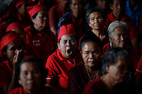 """Supporters of ousted premier Thaksin Shinawatra attend a religious ceremony at a temple in the village of Suan Mon near Udon Thani in northeastern Thailand June 25, 2011. Regional leaders of Thailand's red-shirt protest movement held traditional Buddhist ceremony to launch 38 villages designated as """"Red Shirt Village of Democracy."""" The red shirts, supporters of ousted premier Thaksin Shinawatra, have been branding hundreds of villages as red to rally behind Thaksin's sister, Yingluck, who is leading the opposition ahead of July 3 general elections.   REUTERS/Damir Sagolj (THAILAND)"""