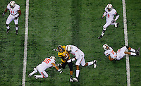 Missouri quarterback James Franklin is tackled during the Cotton Bowl game between Oklahoma State and Missouri on January 3, 2014 at AT&T Stadium in Arlington, Texas.