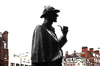 """Sherlock Holmes, """"The Great Detective"""", bronze statue, 1999, John Doubleday, commissioned by Sherlock Holmes Society of London, Baker Street, silhouetted against an opaque morning light, London, UK. Picture by Manuel Cohen"""