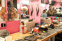 6:11 P.M. 3011 BUFORD HIGHWAY N.E.: I got a glimpse into the drag queen world while shooting backstage at Lips Atlanta, a drag dinner theater. The drag queens who perform there arrived in their street clothes and transformed themselves in front of me.