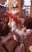 People rub lucky cloths on a pole before the beginning of the Naked Man Festival (Hadaka Matsuri) in Kounomiya, Nagoya.