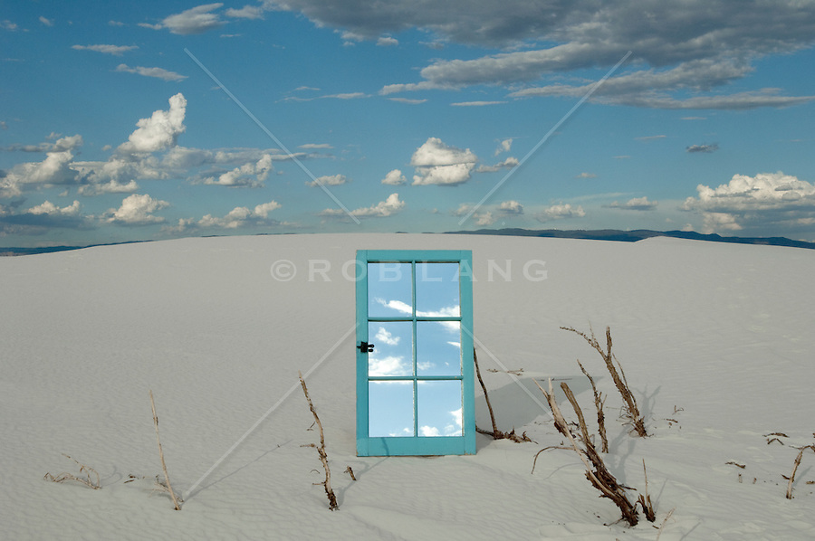 mirrored window on a sand dune in White Sands, NM