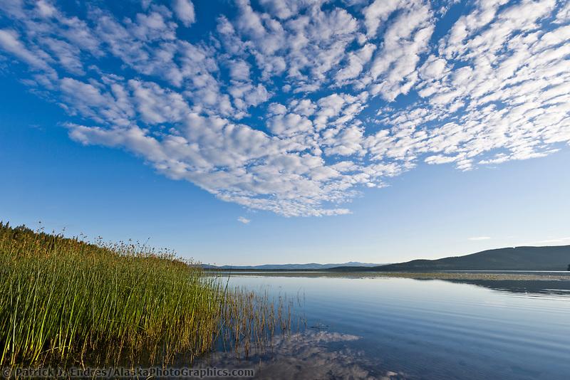 Could patterns over Quartz lake on a sunny, summer day, interior, Alaska.