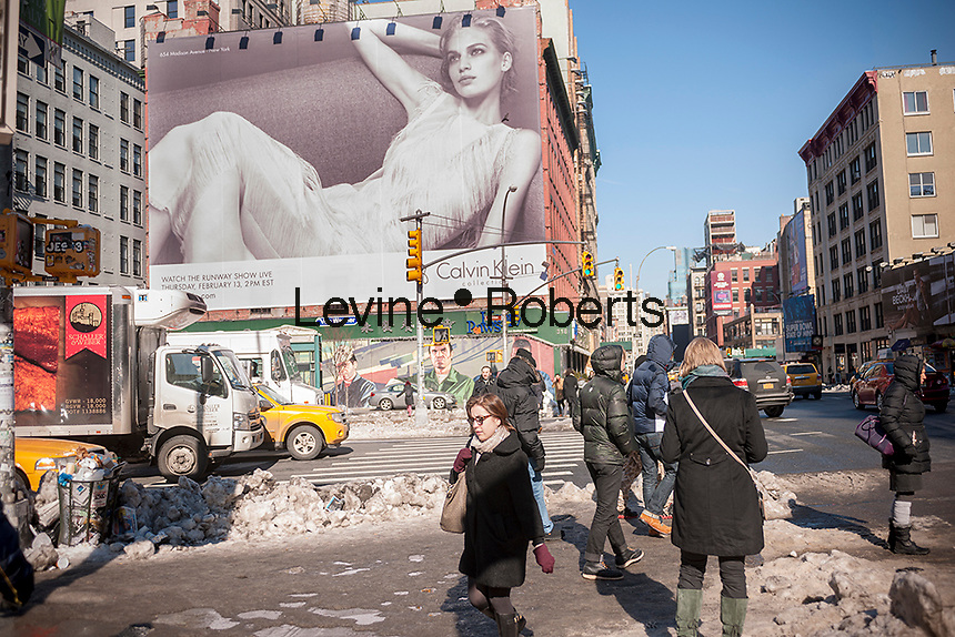 A Calvin Klein billboard in the Soho neighborhood of New York on Friday, February 7, 2014 promotes a webcast of Klein's Fall 2014 Fashion Show. Klein's advertisements use sex and provocative images to test society's cultural and moral boundaries. (© Richard B. Levine)