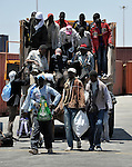 Fleeing Libya's civil war, migrant workers from other African countries get off a truck in Misrata's port, ready to board a ship to take them home to Ghana, Niger, Sudan, and other nearby nations. Even if not fearing for their safety, many of the migrants are leaving because the economy in Misrata, surrounded by troops loyal to strongman Moammar Gadhafi, is at a standstill.
