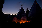 Cannon Ball, North Dakota<br /> September 24, 2016<br /> <br /> The Standing Rock Sioux encampment near the construction of the Dakota Access Pipeline stands against the construction of the new pipeline. <br /> <br /> The Standing Rock Sioux, whose tribal lands are a half-mile south of the proposed route, say the pipeline would desecrate sacred burial and prayer sites, and could leak oil into the Missouri and Cannon Ball rivers, on which the tribe relies for water.<br /> <br /> Opposition to the pipeline has drawn support from 200 Native American tribes, as well as from activists and celebrities. <br /> <br /> Energy Transfer Partners&mdash;one of the major stakeholders in the controversial Dakota Access pipeline&mdash;bought over 6,000 acres of land surrounding the line&rsquo;s route in North Dakota, according to several media reports over the weekend.