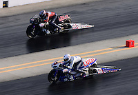 Sept. 14, 2012; Concord, NC, USA: NHRA pro stock motorcycle rider Hector Arana Jr (near lane) races alongside his father Hector Arana Sr during qualifying for the O'Reilly Auto Parts Nationals at zMax Dragway. Mandatory Credit: Mark J. Rebilas-