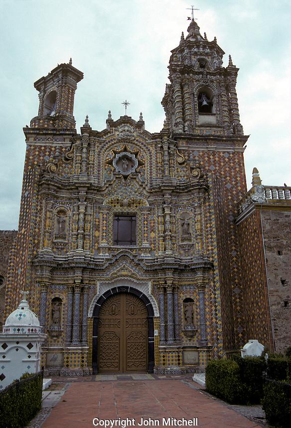 The Talavera tiled facade of the 18th century Templo de San Francisco in Acatepec, Puebla, Mexico