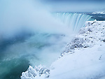 Niagara Falls Horseshoe waterfall covered with snow, wintertime scenic. Ontario, Canada.