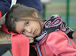 A tired girl inside a refugee processing center in the Serbian village of Presevo, not far from the Macedonian border. Hundreds of thousands of refugees and migrants--including many children--have flowed through Serbia in 2015, on their way from Syria, Iraq and other countries to western Europe.