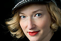 Blond woman with Smiling face and biker hat