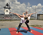 Hillary Sweeney and companion from Westchester Circus Arts performing at a ceremony for the restoration of the Sleepy Hollow Light House.