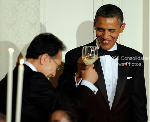 United States President Barack Obama and South Korean President Lee Myung-bak toast each other during a State Dinner in the East Room of the White House in Washington, DC on Thursday, October 13, 2011. The State Visit comes only a day after Congress passed a free trade agreement with South Korea.   .Credit: Roger L. Wollenberg / Pool via CNP