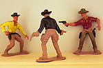 Three model cowboys in shootout