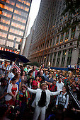 New York, New York<br /> September 29, 2011<br /> <br /> Occupy Wall Street protesters march on Wall Street after the closing bell at the New York Stock Exchange. The police cordon off the area and control protesters as they march from their encampment at Zuccotti Park near Ground Zero and the financial district.<br /> <br /> The participants of the event, that began on September 17,  are mainly protesting against social and economic inequality, corporate greed, and the influence of corporate money and lobbyists on government, among other concerns.<br /> <br /> About 1,000 people have been arrested so far - most on misdemeanor disorderly conduct charges related to blocking traffic or refusing police orders to move.