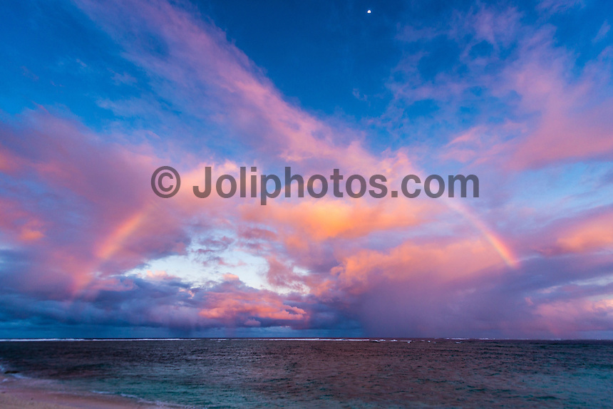 Namotu Island Resort, Namotu, Fiji. (Tuesday May 20, 2014) Rainbow over Namotu Is.– There were light winds early today with sunshine and the odd passing shower producing rainbows on and off all morning. There were small wave sessions at Cloudbreak and Namotu Lefts for some of the guests. Photo: joliphotos.com
