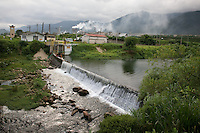 People swimming in the weir by Fosfertil fertilser factory, Cubatão